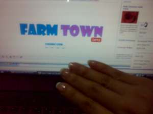 Farm Town while having my manicure and pedicure